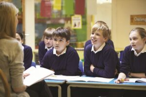 How should a teacher behave in a classroom